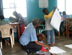 Ashesi faculty member works with a child