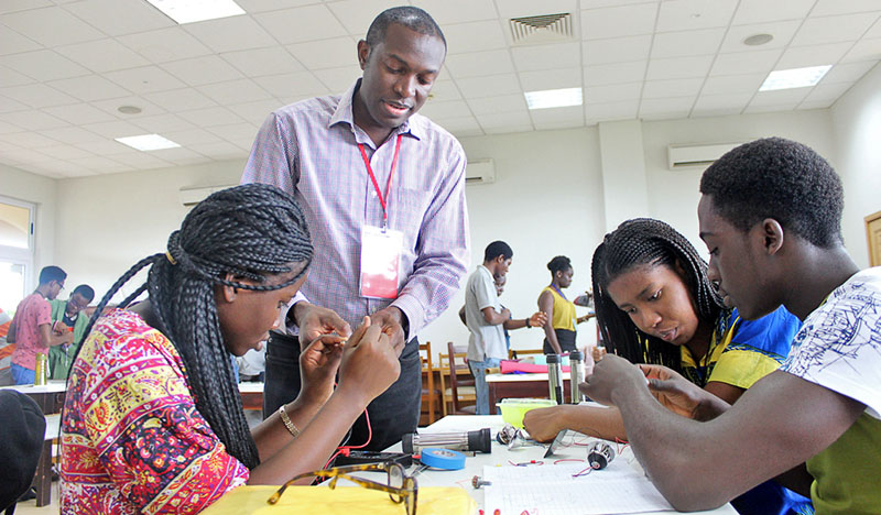 Students get coaching from Ashesi Professor